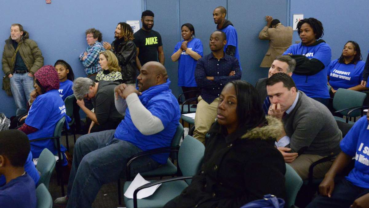 Advocates for and against conversion await a vote on the surprise resolution to begin the conversion process at East Germantown's Wister Elementary school. (Bastiaan Slabbers for WHYY)