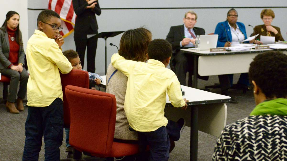 Over 60 parents, students, teachers and community members testified before the SRC Thursday. Early in the meeting, Novilette Jones and her children thanked Hite for pushing to keep Wister under district control. (Bastiaan Slabbers for NewsWorks)