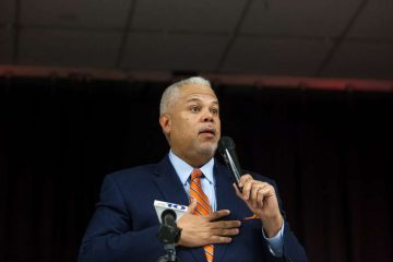 State Sen. Anthony Hardy Williams opens a community meeting on neighborhood safety addressing the recent shooting of Philadelphia Police Officer Jesse Hartnett in Cobbs Creek section in 2017. (Brad Larrison for WHYY)