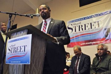 Sharif Street launches his campaign for state Senate in 2017. Behind him are (from right) his father, former Philadelphia Mayor John Street and former U.S. Rep. Chaka Fattah. (Emma Lee/WHYY)