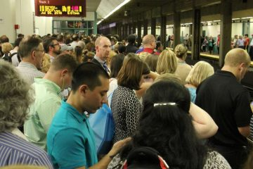 <p>Regional rail passengers pack the platforms at Suburban Station at rush hour. (Emma Lee/WHYY)</p>