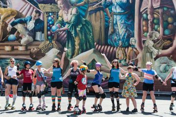 Members of Philly Roller Derby practice a dance routine at the start of Philadelphia Pride Parade and Festival in 2017. (Branden Eastwood for WHYY)
