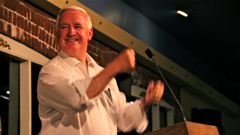 Pennsylvania Gov. Tom Corbett tries to win laughs at a candidates' comedy night Thursday (Emma Lee/WHYY)