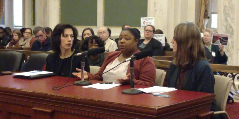Nifia Medley (center) spoke Monday before Philadelphia City Council. She has been living in a homeless shelter with her 8-year-old daughter for 14 months.  (Katie Colaneri/WHYY)
