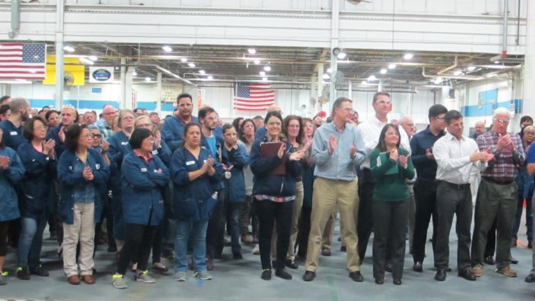 Workers at Zodiac Aero Evacuation Systems celebrate  10 years of New Jersey's Basic Skills Workforce Training Program at the company in Wall. (Phil Gregory/WHYY)
