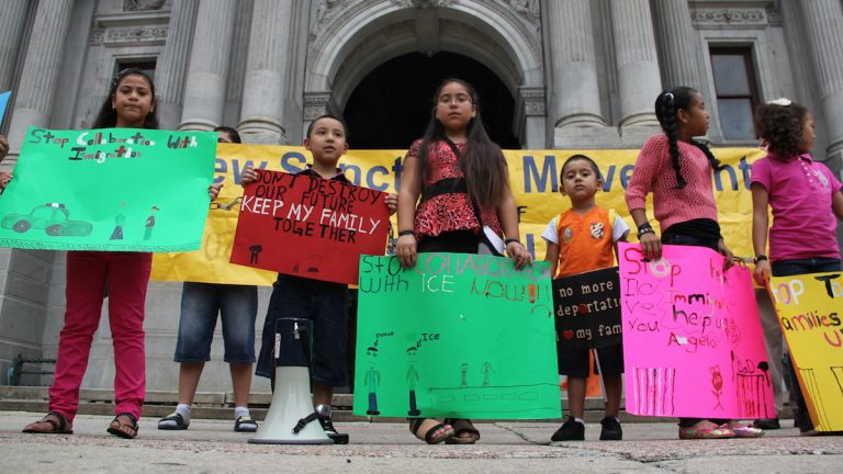 Children of immigrants stand in front of City Hall to protest city policies they say are tearing their families apart. (Emma Lee/for NewsWorks)