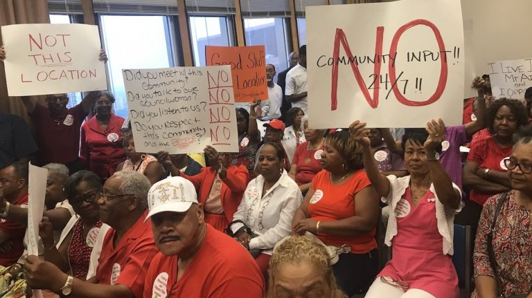 Residents pack a Zoning Board of Adjustment hearing Tuesday to protest a medical marijuana dispensary, which in March gained city approved to open in Mt. Airy. (Bobby Allyn / WHYY)