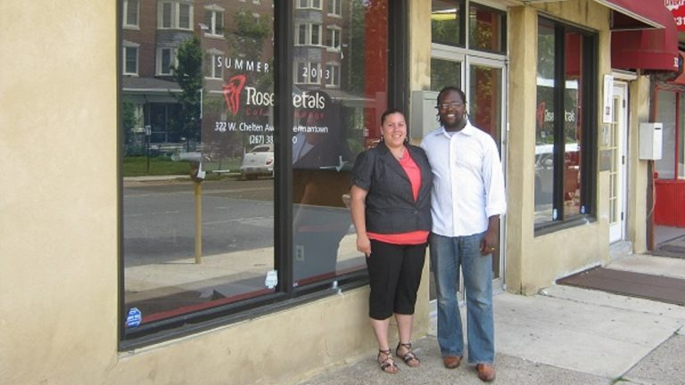 Desmin and Jania Daniels stand outside what will soon be their restaurant on West Chelten Avenue in Germantown. (Alaina Mabaso/for NewsWorks)