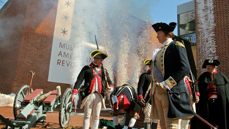 Revolutionary War reenactors and pyrotechnics accompany the announcement of the beginning of site preparation for the Museum of the American Revolution at Third and Chestnut streets. (Emma Lee/WHYY)