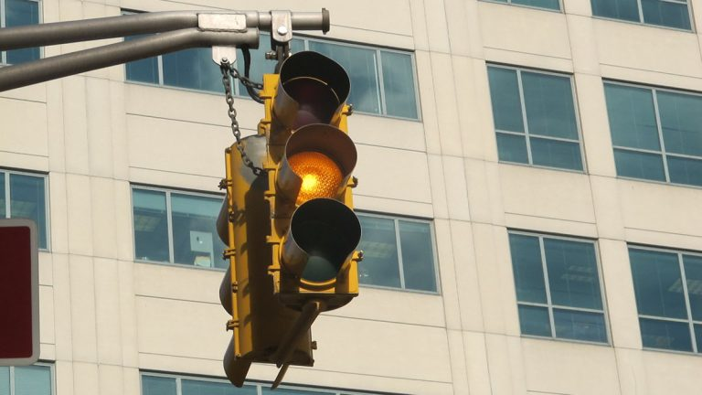 Traffic signal with yellow light on West State Street in Trenton. (Phil Gregory/WHYY)