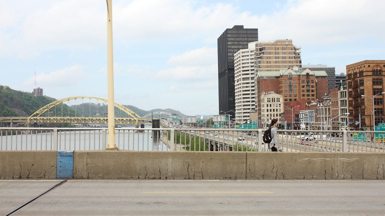 A new ramp will connect the deck of the Smithfield Street Bridge in downtown Pittsburgh with two riverfront trail systems. A long switchback will soften the 40-foot drop between the bridge and the path below. (Margaret J. Krauss/WESA)