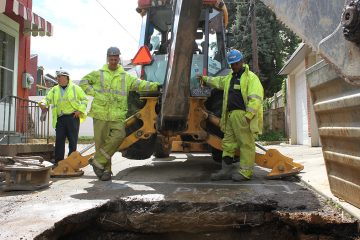 More than 30 percent of Pennsylvania's water systems aren't as resilient as they need to be, according to the Bureau of Safe Drinking Water. Pittsburgh's system has suffered from lack of investment. In the city's Lawrenceville neighborhood, a Pittsburgh Water and Sewer Authority (PWSA) crew, uncovered and fixed a leaking water main. From left, foreman Mike Gigliotti, Anthony Colapietro, and Eugene Tyler. Joe Ganzer, not pictured, manned the excavator. (Margaret J. Krauss/WESA)