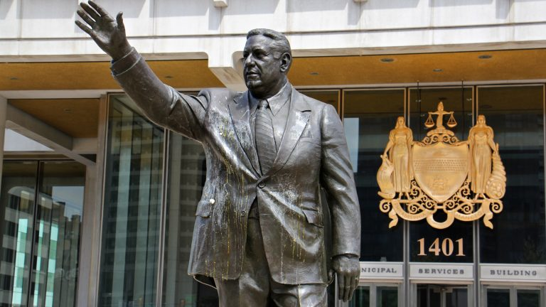 The statue of former Philadelphia Mayor Frank Rizzo drips with egg  in this August 2017 file photo. Last summer, the statue was increasingly the target of vandals and protesters who see it as a symbol of racism. (Emma Lee/WHYY)