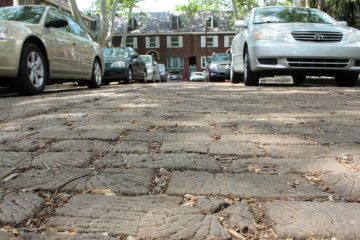 Roslyn Place, in Pittsburgh's Shadyside neighborhood, is one of the last wooden streets in the United States. It was recently designated a City Historic Site, which protects it from alterations. Philadelphia's wooden street, S. Camac Street, is covered with asphalt but is expected to be restored in 2018. (Margaret J. Krauss/WESA)