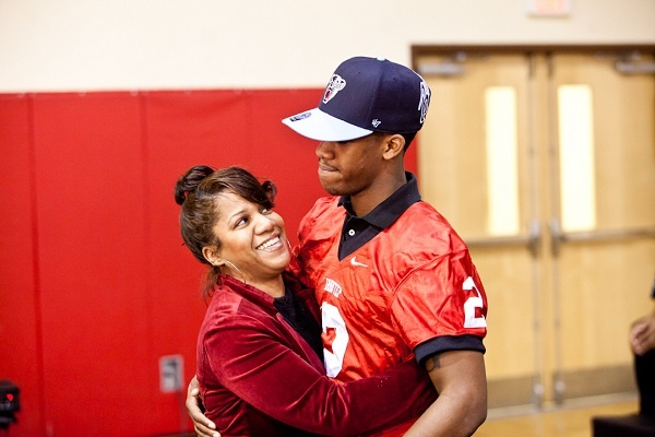 <p><p>Najee Goode and his mother Felicia embrace on National Signing Day. (Brad Larrison/for NewsWorks)</p></p>