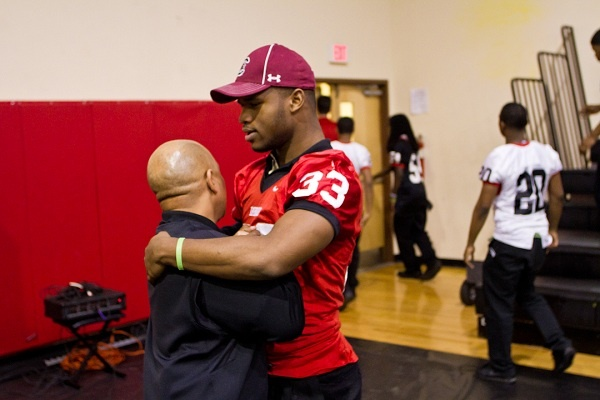 <p><p>Running back David Williams and Coach Albie Crosby hug after Imhotep's National Signing Day event on Wednesday morning. They were together at West Catholic prior to Imhotep. (Brad Larrison/for NewsWorks)</p></p>
