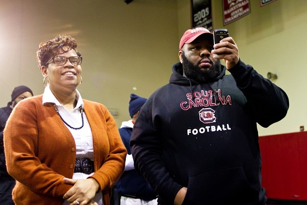 <p><p>David Williams' mother and godfather, Tamara Bunch and Rodney Veney, looked on and took pictures of the newest South Carolina Gamecock on Wednesday. (Brad Larrison/for NewsWorks)</p></p>