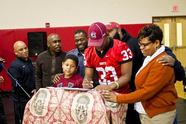 <p><p>David Williams stands next to his mother Tamara and other family members while signing with the University of South Carolina. His mom said the choice was between two schools from which coaches thought to visit her. (Brad Larrison/for NewsWorks)</p></p>
