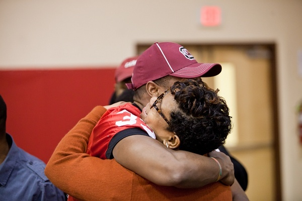 <p><p>David Williams hugs his mother Tamara after signing with the University of South Carolina on Wednesday morning. (Brad Larrison/for NewsWorks)</p></p>