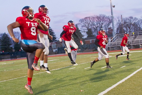 <p><p>At practice, Imhotep's players on defense wear red while the offense wears black. (Brad Larrison/for NewsWorks)</p></p>