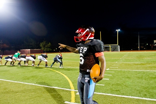 <p><p>Eerin Young, one of Imhotep's premier running backs, talks about the play he just ran during Tuesday's practice. (Brad Larrison/for NewsWorks)</p></p>