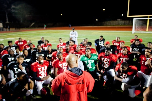 <p><p>Imhotep Institute Charter High School football head coach Albie Crosby addresses the team as they prepare to host a state semifinal game this weekend in Germantown. (Brad Larrison/for NewsWorks)</p></p>