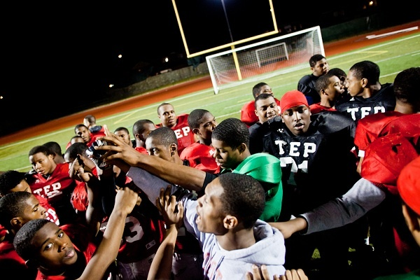"<p><p>The Imhotep Panthers closed out Tuesday's practice with a huddle and a ""Family"" yell. (Brad Larrison/for NewsWorks)</p></p>"