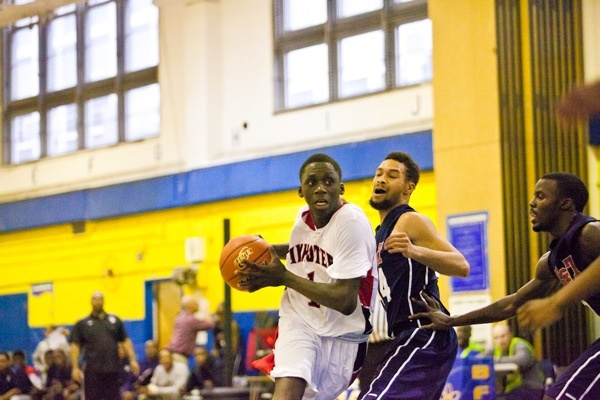 Brandon Austin of Imhotep tries to get to the basket in action against Philadelphia Electrical on Saturday. (Brad Larrison/for NewsWorks)