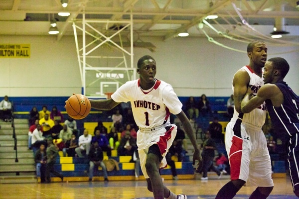Imhotep's Brandon Austin moves up the court during his team's 51-43 win over Philadelphia Electrical on Saturday. (Brad Larrison/for NewsWorks)