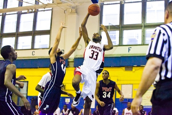 Imhotep's Jalil Myers goes to the hoop. (Brad Larrison/for NewsWorks)