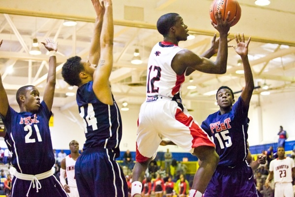 Imhotep's Jakwan Jones tries to put two more on the board. (Brad Larrison/for NewsWorks)