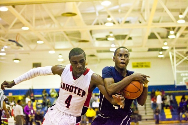 Abraham Massaley of Imhotep tries to strip the ball from James Bishop during Imhotep's 51-43 win Saturday. (Brad Larrison/for NewsWorks)