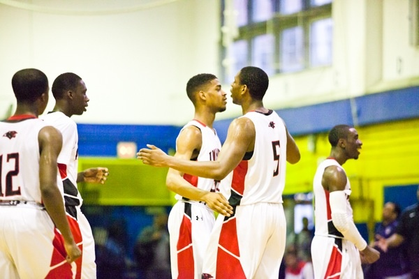 Nigel Grant and Basil Thompson of Imhotep hug after a timeout was called with less than a minute left in the fourth quarter. (Brad Larrison/for NewsWorks)
