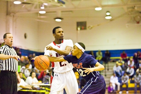 Khaalis Carter of Philadelphia Electrical tries to strip the ball from Imhotep Guard Deryl Bagwell. (Brad Larrison/for NewsWorks)
