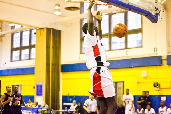 Brandon Austin of Imhotep seals the deal and dunks the ball with only a few seconds left in regulation. Imhotep topped Philadelphia Electrical 51-43 on Saturday. (Brad Larrison/for NewsWorks)