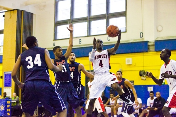 Abraham Massaley of Imhotep Charter with the layup. (Brad Larrison/for NewsWorks)