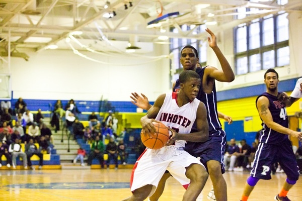 Jakwan Jones of Imhotep Charter moves up the court in his team's 51-43 win over Philadelphia Electrical on Saturday. (Brad Larrison/for NewsWorks)