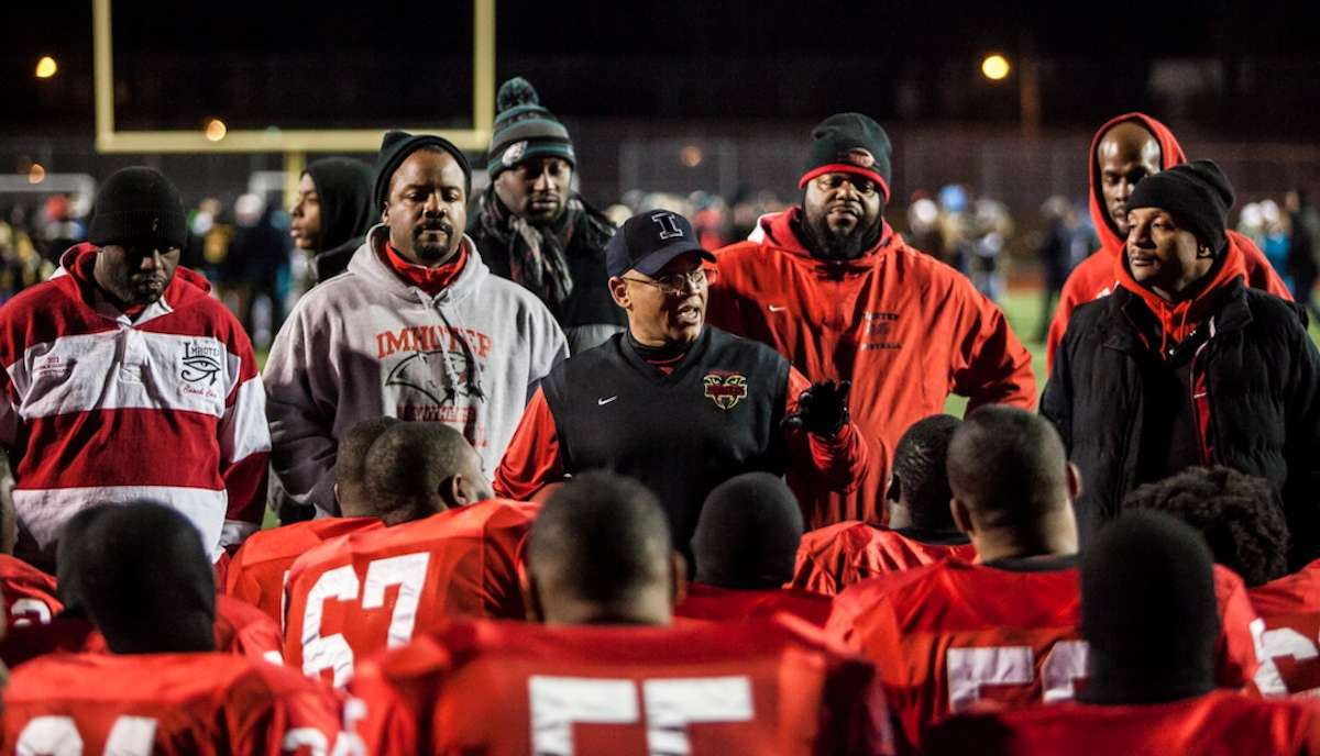 Imhotep Head Coach Albie Crosby speaks about his love for a team that fought back and fell just short in the AAA championship game. (Brad Larrison/for NewsWorks)