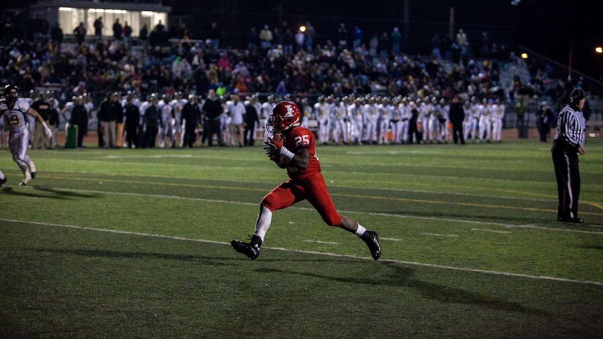 Imhotep running back Mike Waters glides into the endzone in Imhotep's first possesion of the second half. (Brad Larrison/for NewsWorks)