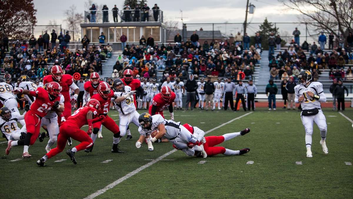 Alex Arcangeli is brought down by the Imhotep defense during Wood's second drive. (Brad Larrison/for NewsWorks)