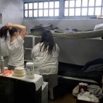 Female inmates interact in their cell in this file photo. (Rick Bowmer/AP Photo, Pool)
