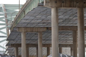 In this file photo, a covering is in place under the superstructure as work continues on the Birmingham Bridge that spans the Monongahela River in Pittsburgh.  (AP file Photo/Keith Srakocic)
