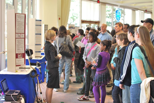 "<p><p class=""p1"">Marian Bechtel, Seaborg Award winner of the 2012 Intel Science Talent Search speaking to attendees of Public Day about her project. (Courtesy of Society for Science & the Public)</p></p>"
