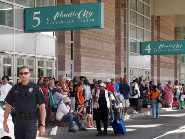 A police officer is on crowd-control duty outside the Atlantic City Convention Center, which is being used as an evacuation center for hundreds of city residents fleeing the approach of Hurricane Irene. (AP Photo/Wayne Parry)