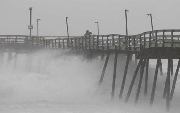 In the Outer Banks of N.C., a fishing pier looses pilings. On Saturday night, Atlantic City, N.J., and other evacuated shore towns stood in the path of the hurricane. (AP Photo/Charles Dharapak)