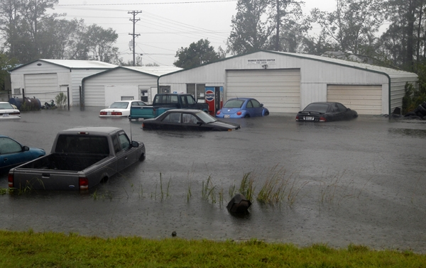Vehicles sit in flood waters at a auto repair shop in North Carolina on Saturday. Phila. Nutter and other officials are extremely worried about regional flooding. (AP Photo/Chuck Burton)