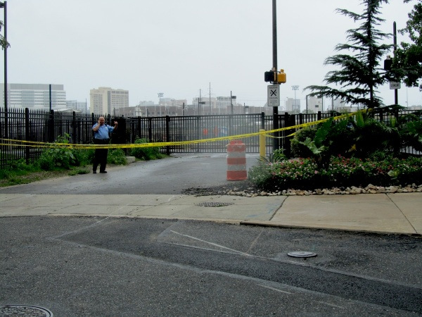 The Schuylkill River path is taped off and guarded. (Kimberly Paynter/For NewsWorks)