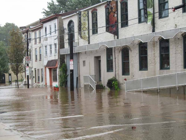 Manayunk residents saw flooding early Sunday along Main Street. (Megan Pinto/For NewsWorks)
