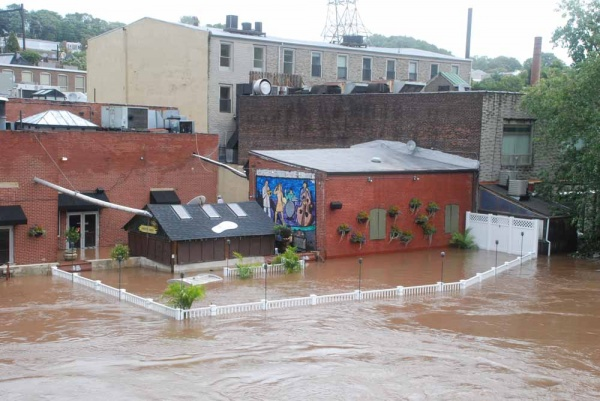 The back deck of Manayunk Brewery is completely underwater (Max Matza/for NewsWorks)