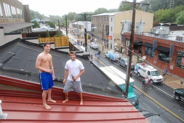 From their roof, college students Joe Schurr and Kerry Gallagher enjoy their